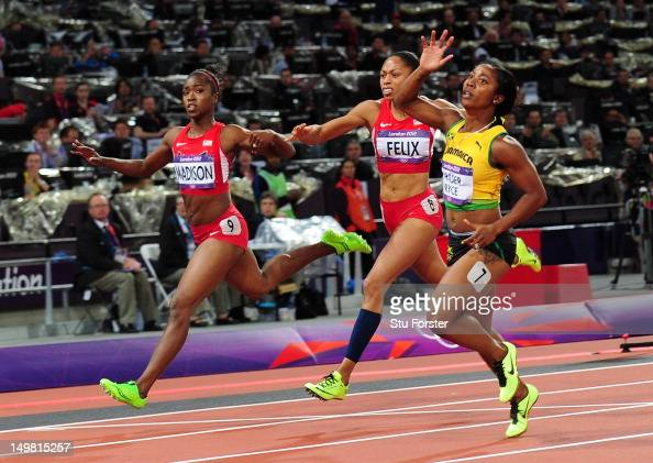 ShellyAnn FraserPryce of Jamaica crosses the line to win the gold ahead of Allyson Felix of the United States and Tianna Madison of the United States...