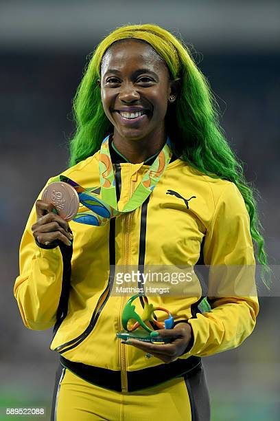 ShellyAnn FraserPryce of Jamaica poses with the bronze medal for the Women's 100 meters on Day 9 of the Rio 2016 Olympic Games at the Olympic Stadium...