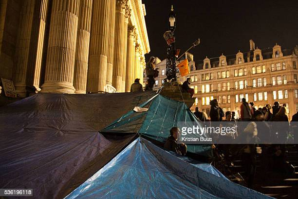 A shelter made out of tarpoulin next to the front steps to the cathedral The London Stock Exchange was attempted occypied in solidarity with Occupy...