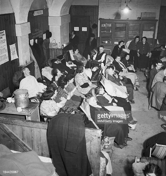 Shelter Photographs Taken In London By Bill Brandt November 1940 Christ Church Spitalfields Rows of Londoners seated in the crypt 6 November 1940