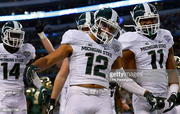 J Shelton of the Michigan State Spartans celebrates his touchdown against the Baylor Bears with Tony Lippett of the Michigan State Spartans and Colar...