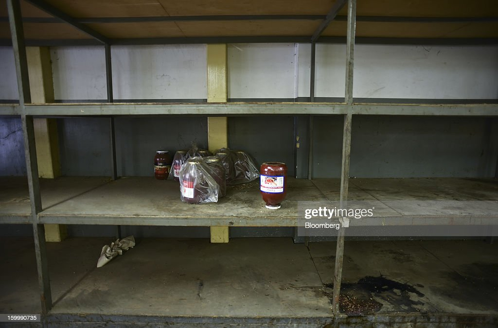 Shelves are almost entirely bare at a private sector food distributor's warehouse in central Caracas, Venezuela, on Monday, Jan. 14, 2013. According to the manager, he has not been able to stock basic food items like sugar, coffee, meat or milk for weeks because of nationwide food shortages. The government is conducting a nationwide campaign to crack down on over-pricing and hoarding it blames for shortages of basic goods, from toilet paper to sugar. Photographer: Meridith Kohut/Bloomberg via Getty Images