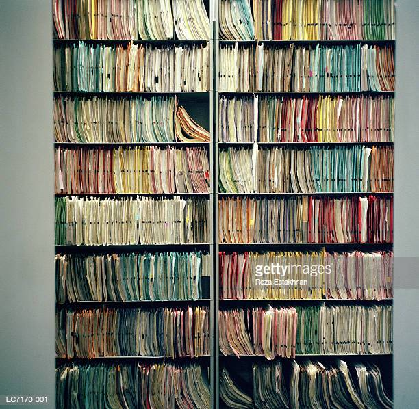 Shelves filled with patient notes and files