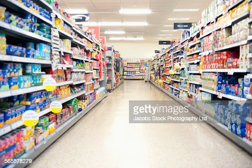 Shelves in grocery store aisle