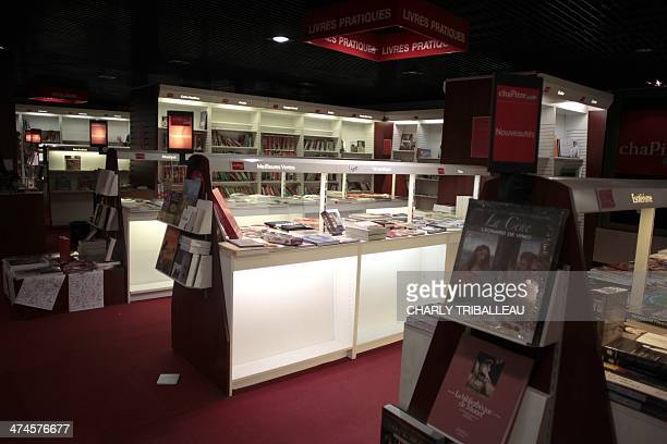 Shelves of books are partially empty early on February 24 2014 in a shop of 'Chapitre' book and cultural product network occupied by employees in...