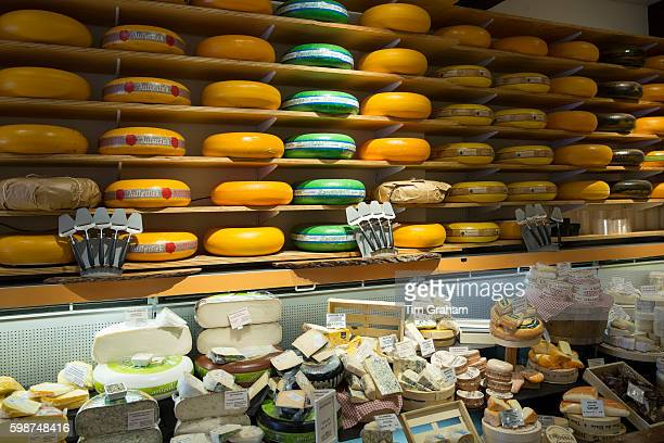 Shelves of cheese wheels at traditional cheese shop Gouds Kaashuis in Hoogstraat in Gouda The Netherlands