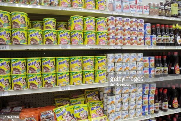 Shelves of chocolate milk powder for sale at La Colonia Supermarket