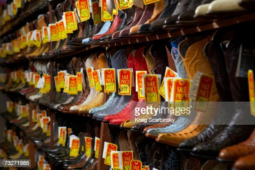 Rack Of Cowboy Boots In Shoe Store Full Frame Stock Photo | Getty ...