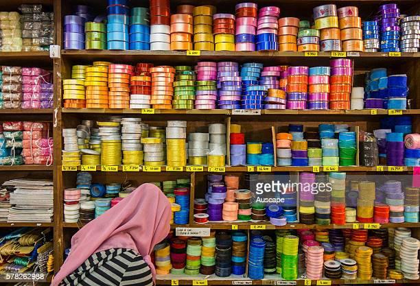 Shelves of ribbons in a ribbon shop Yogyakarta Java Indonesia