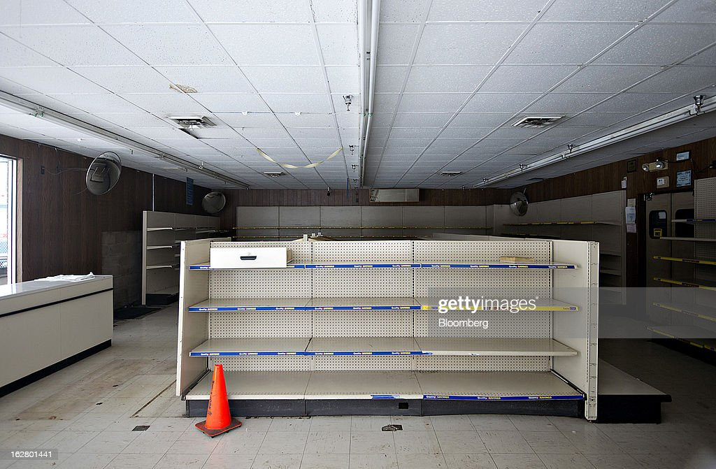 Shelves sit empty inside a closed Hostess Brands Inc. bakery outlet store in Peoria, Illinois, U.S., on Wednesday, Feb. 27, 2013. Flowers Foods Inc., maker of packaged bakery foods, won the bidding for the majority of the bread-making business of Hostess Brands Inc., including the Wonder, Butternut, Home Pride, Merita and Nature's Pride brands, 20 bread plants, 38 depots and other assets, after no other competing offers were submitted. Photographer: Daniel Acker/Bloomberg via Getty Images