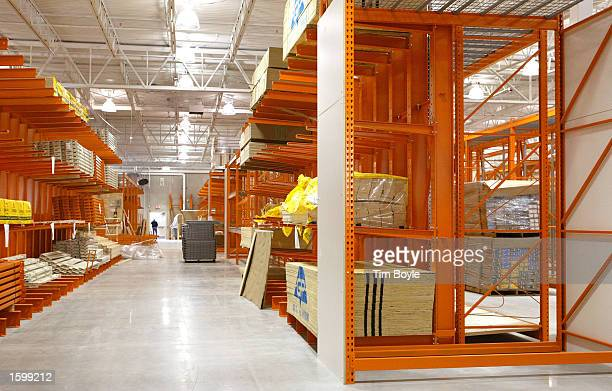 Shelves waiting to be stocked are visible inside a new Home Depot store November 8 2002 in Niles Illinois Founded in 1978 The Home Depot operates...