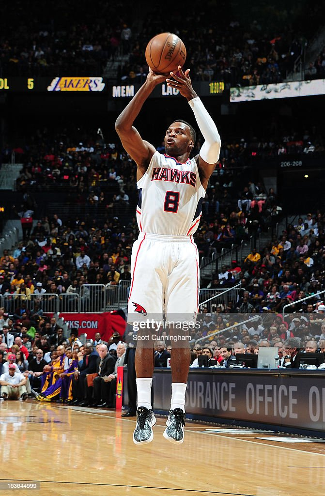 Shelvin Mack #8 of the Atlanta Hawks attempts a shot against the Los Angeles Lakers on March 13, 2013 at Philips Arena in Atlanta, Georgia.