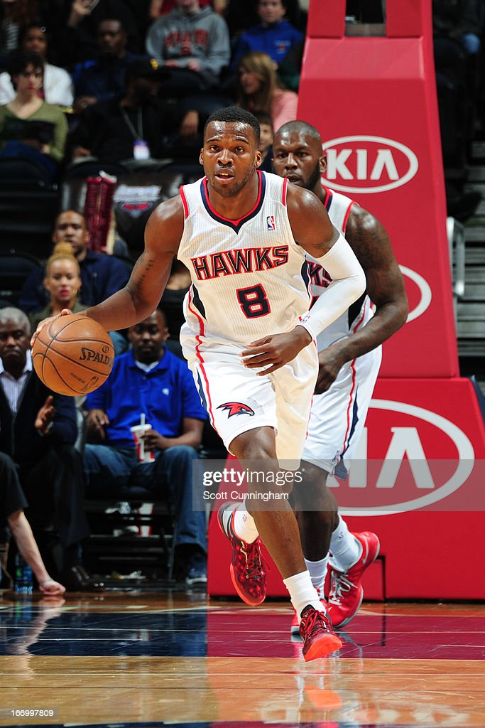 <a gi-track='captionPersonalityLinkClicked' href=/galleries/search?phrase=Shelvin+Mack&family=editorial&specificpeople=5767272 ng-click='$event.stopPropagation()'>Shelvin Mack</a> #8 of the Atlanta Hawks brings the ball up court against the Philadelphia 76ers on April 5, 2013 at Philips Arena in Atlanta, Georgia.