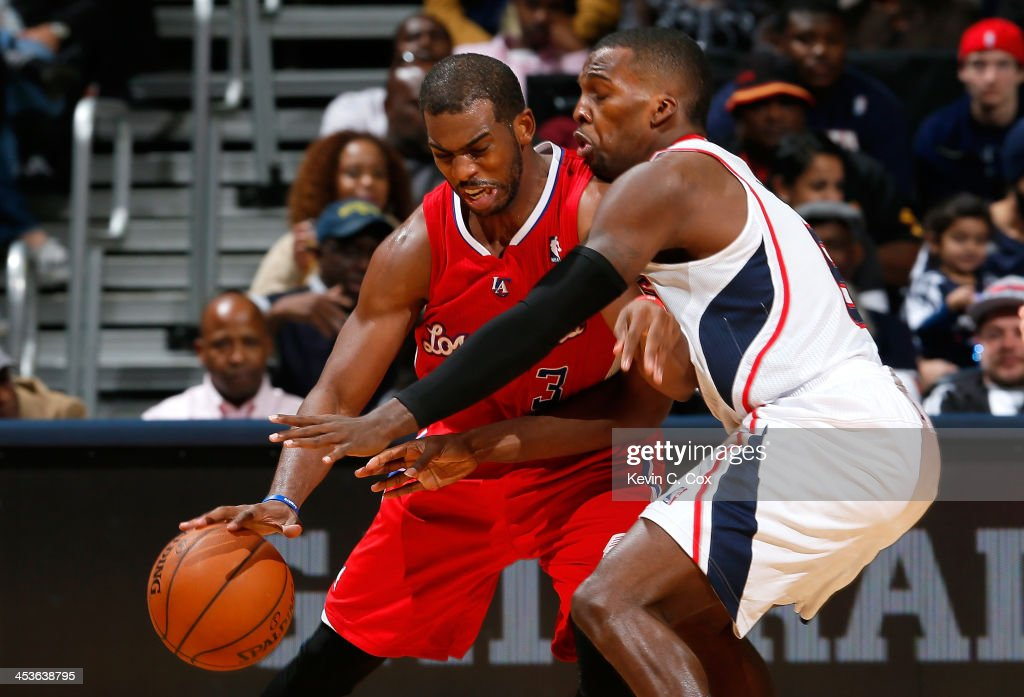 <a gi-track='captionPersonalityLinkClicked' href=/galleries/search?phrase=Shelvin+Mack&family=editorial&specificpeople=5767272 ng-click='$event.stopPropagation()'>Shelvin Mack</a> #8 of the Atlanta Hawks defends against <a gi-track='captionPersonalityLinkClicked' href=/galleries/search?phrase=Chris+Paul&family=editorial&specificpeople=212762 ng-click='$event.stopPropagation()'>Chris Paul</a> #3 of the Los Angeles Clippers at Philips Arena on December 4, 2013 in Atlanta, Georgia.