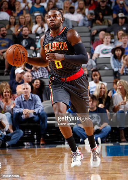 Shelvin Mack of the Atlanta Hawks dribbles the ball against the Dallas Mavericks during a preseason game on October 16 2015 at the American Airlines...