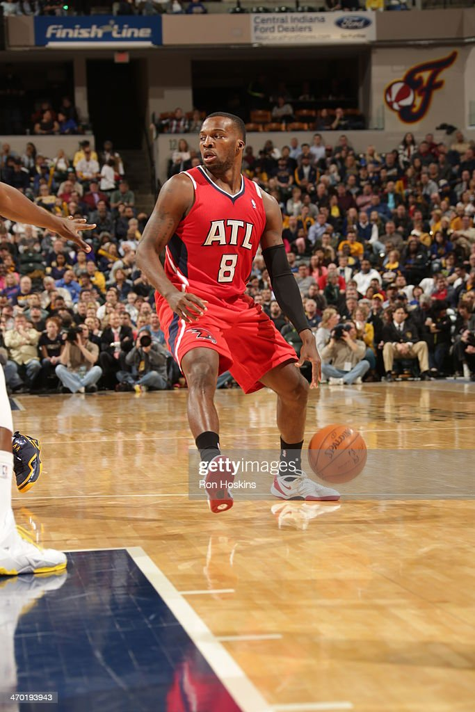 <a gi-track='captionPersonalityLinkClicked' href=/galleries/search?phrase=Shelvin+Mack&family=editorial&specificpeople=5767272 ng-click='$event.stopPropagation()'>Shelvin Mack</a> #8 of the Atlanta Hawks drives against the Indiana Pacers at Bankers Life Fieldhouse on February 18, 2014 in Indianapolis, Indiana.