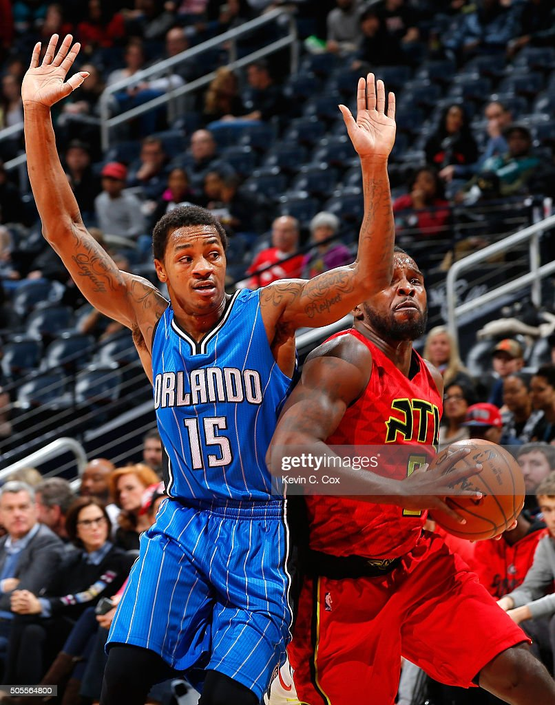 Shelvin Mack of the Atlanta Hawks drives againts Keith Appling of the Orlando Magic at Philips Arena on January 18 2016 in Atlanta Georgia NOTE TO...