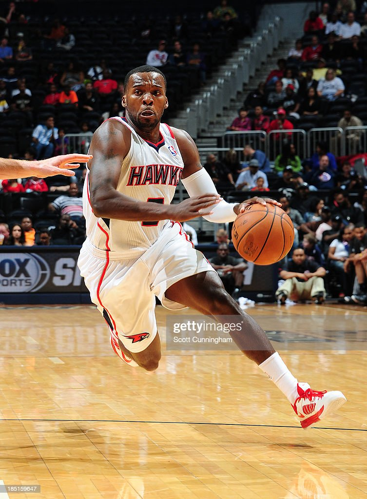 <a gi-track='captionPersonalityLinkClicked' href=/galleries/search?phrase=Shelvin+Mack&family=editorial&specificpeople=5767272 ng-click='$event.stopPropagation()'>Shelvin Mack</a> #8 of the Atlanta Hawks drives to the basket against the San Antonio Spurs on October 17, 2013 at Philips Arena in Atlanta, Georgia.
