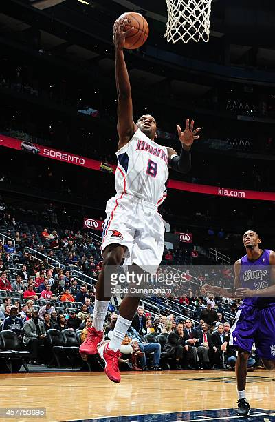 Shelvin Mack of the Atlanta Hawks drives to the basket against the Sacramento Kings on December 18 2013 at Philips Arena in Atlanta Georgia NOTE TO...