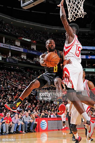 Shelvin Mack of the Atlanta Hawks drives to the basket and passes the ball against the Houston Rockets on December 29 2015 at the Toyota Center in...