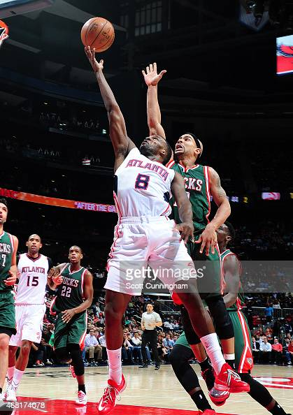 Shelvin Mack of the Atlanta Hawks goes for the layup against the Milwaukee Bucks during the game on March 30 2015 at Philips Arena in Atlanta Georgia...