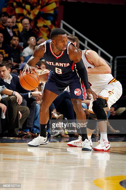Shelvin Mack of the Atlanta Hawks handles the ball against the Cleveland Cavaliers at The Quicken Loans Arena on December 17 2014 in Cleveland Ohio...