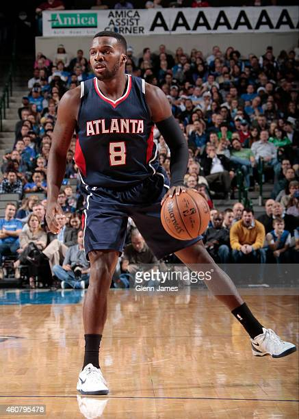 Shelvin Mack of the Atlanta Hawks handles the ball against the Dallas Mavericks on December 22 2014 at the American Airlines Center in Dallas Texas...