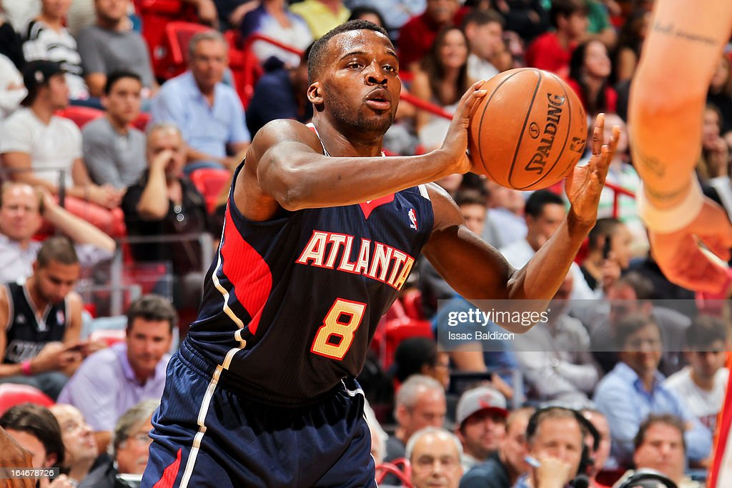 Shelvin Mack #8 of the Atlanta Hawks looks to pass the ball against the Miami Heat on March 12, 2013 at American Airlines Arena in Miami, Florida.