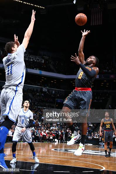 Shelvin Mack of the Atlanta Hawks shoots against Brook Lopez of the Brooklyn Nets during the game on NOVEMBER 17 2015 at Barclays Center in Brooklyn...