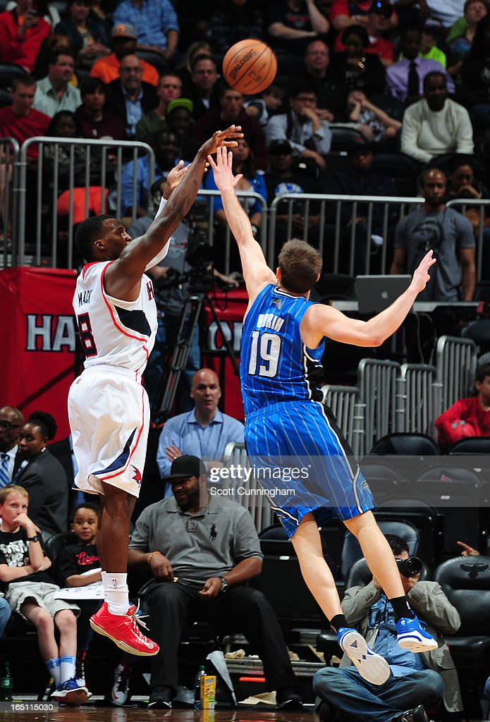 Shelvin Mack #8 of the Atlanta Hawks takes a shot against Beno Udrih #19 of the Orlando Magic on March 30, 2013 at Philips Arena in Atlanta, Georgia.