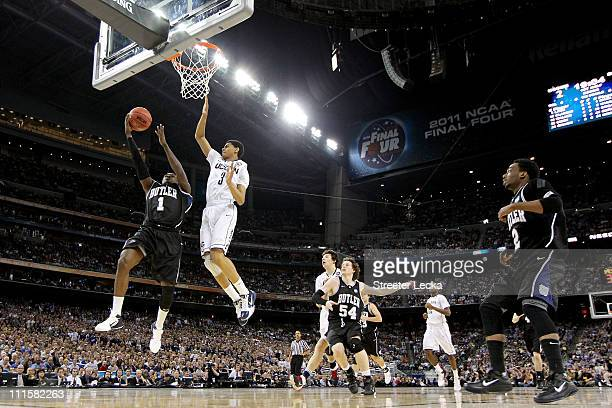 Shelvin Mack of the Butler Bulldogs goes to the basket against Jeremy Lamb of the Connecticut Huskies during the National Championship Game of the...
