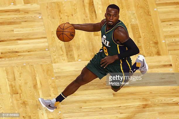 Shelvin Mack of the Utah Jazz dribbles against the Boston Celtics during the first quarter at TD Garden on February 29 2016 in Boston Massachusetts