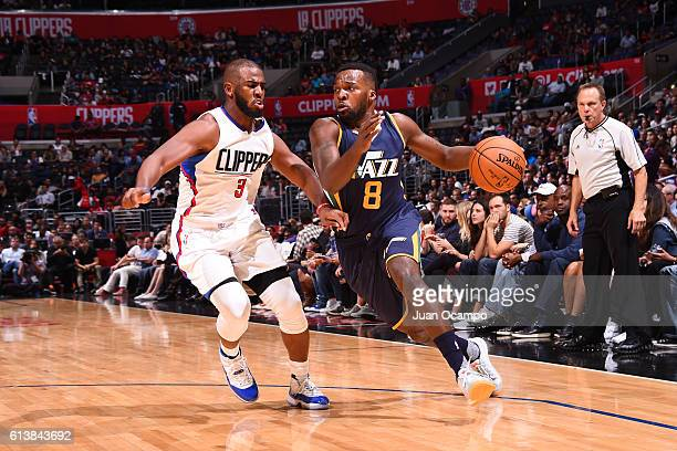 Shelvin Mack of the Utah Jazz drives to the basket against Alan Anderson of the Los Angeles Clippers during a preseason game on October 10 2016 at...