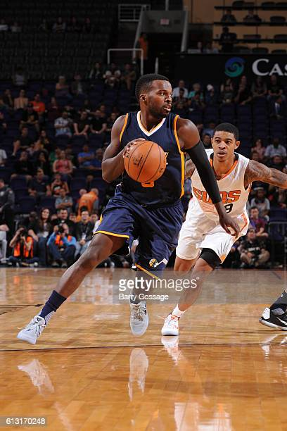 Shelvin Mack of the Utah Jazz handles the ball during a preseason game against the Phoenix Suns on October 5 at Talking Stick Resort Arena in Phoenix...