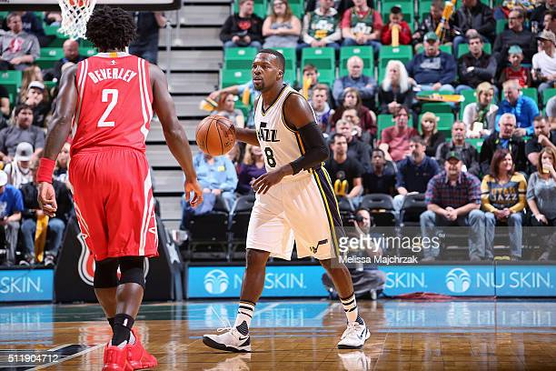 Shelvin Mack of the Utah Jazz handles the ball during the game against Patrick Beverley of the Houston Rockets on February 23 2016 at EnergySolutions...