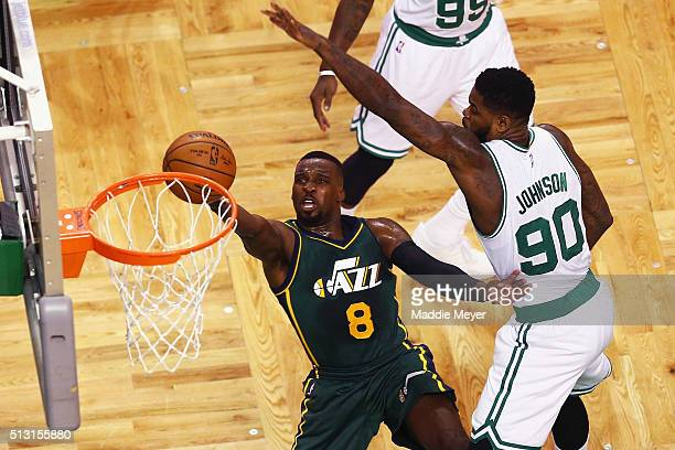 Shelvin Mack of the Utah Jazz takes a shot against Amir Johnson of the Boston Celtics during the first quarter at TD Garden on February 29 2016 in...