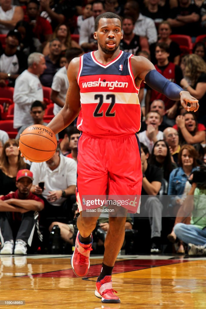 <a gi-track='captionPersonalityLinkClicked' href=/galleries/search?phrase=Shelvin+Mack&family=editorial&specificpeople=5767272 ng-click='$event.stopPropagation()'>Shelvin Mack</a> #22 of the Washington Wizards directs his team against the Miami Heat on January 6, 2013 at American Airlines Arena in Miami, Florida.