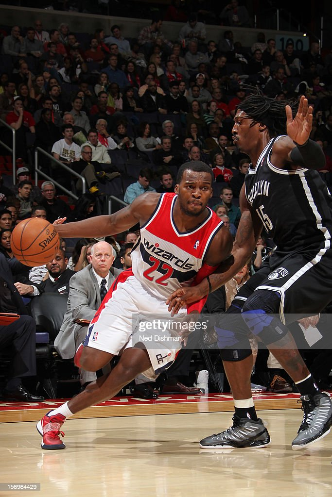 Shelvin Mack #22 of the Washington Wizards drives against Gerald Wallace #45 of the Brooklyn Nets during the game at the Verizon Center on January 4, 2013 in Washington, DC.