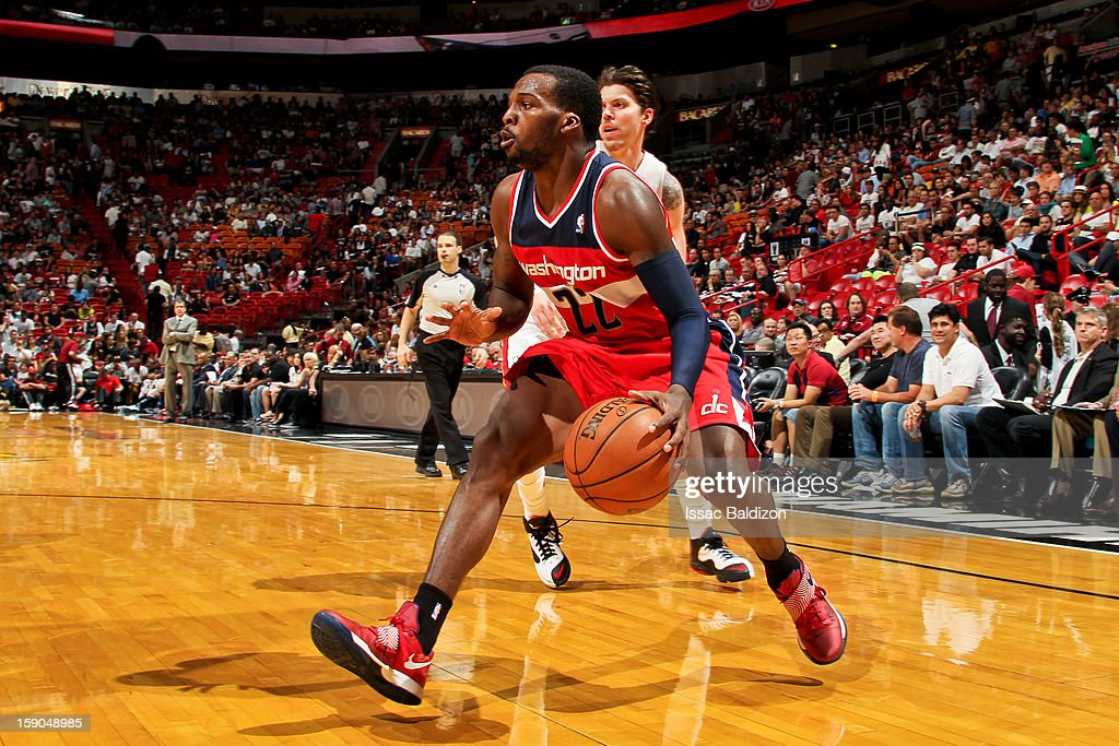 <a gi-track='captionPersonalityLinkClicked' href=/galleries/search?phrase=Shelvin+Mack&family=editorial&specificpeople=5767272 ng-click='$event.stopPropagation()'>Shelvin Mack</a> #22 of the Washington Wizards drives against the Miami Heat on January 6, 2013 at American Airlines Arena in Miami, Florida.
