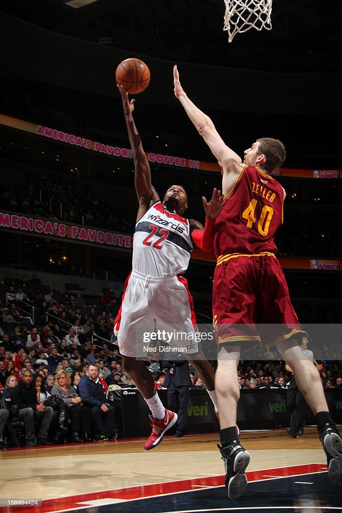 <a gi-track='captionPersonalityLinkClicked' href=/galleries/search?phrase=Shelvin+Mack&family=editorial&specificpeople=5767272 ng-click='$event.stopPropagation()'>Shelvin Mack</a> #22 of the Washington Wizards drives to the basket past <a gi-track='captionPersonalityLinkClicked' href=/galleries/search?phrase=Tyler+Zeller&family=editorial&specificpeople=5122156 ng-click='$event.stopPropagation()'>Tyler Zeller</a> #40 of the Cleveland Cavaliers at the Verizon Center on December 26, 2012 in Washington, DC.