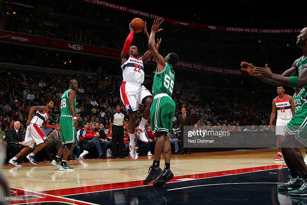 <a gi-track='captionPersonalityLinkClicked' href=/galleries/search?phrase=Shelvin+Mack&family=editorial&specificpeople=5767272 ng-click='$event.stopPropagation()'>Shelvin Mack</a> #22 of the Washington Wizards goes for a jump shot against <a gi-track='captionPersonalityLinkClicked' href=/galleries/search?phrase=E%27Twaun+Moore&family=editorial&specificpeople=4877476 ng-click='$event.stopPropagation()'>E'Twaun Moore</a> #55 of the Boston Celtics during the game between the Washington Wizards and the Boston Celtics at the Verizon Center on January 22, 2012 in Washington, DC.