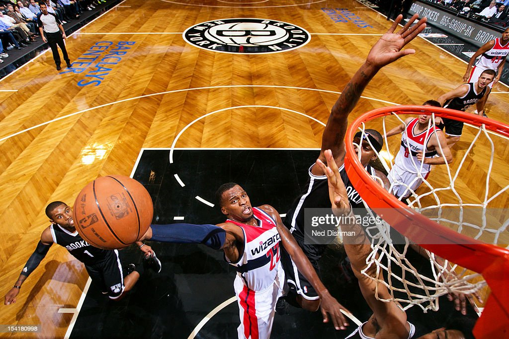 <a gi-track='captionPersonalityLinkClicked' href=/galleries/search?phrase=Shelvin+Mack&family=editorial&specificpeople=5767272 ng-click='$event.stopPropagation()'>Shelvin Mack</a> #22 of the Washington Wizards goes to the basket against the Brooklyn Nets at the Barclays Center on October 15, 2012 in the Brooklyn borough of New York City.