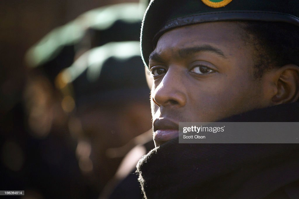 Shem Watson and other students from the Chicago Military Academy participate in the Chicago Veterans Day parade on November 12, 2012 in Chicago, Illinois. Veterans Day, held the anniversary of the signing of the armistice which ended the World War I, is celebrated to honor all veterans for their service.
