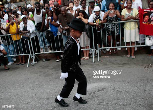 Shemar Williams imitates Michael Jackson's dance the 'moonwalk' outside of the Apollo Theater in Harlem where the deceased pop star first performed...