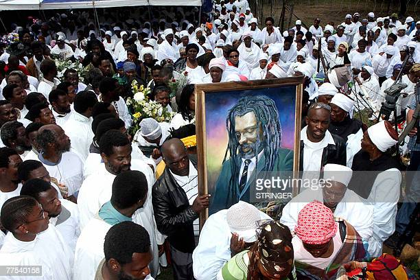 Shembe church of Nazareth worshippers and mourners carry a portrait 28 October 2007 of South African reggae musician Lucky Dube during his funeral...