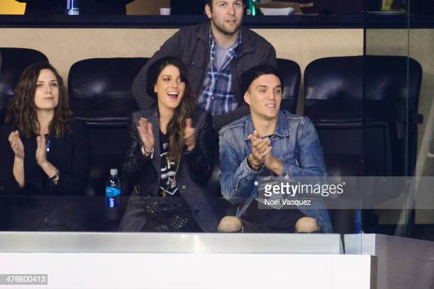 Shenae Grimes and Josh Beech attend a hockey game between the Montreal Canadiens and the Los Angeles Kings at Staples Center on March 3 2014 in Los...