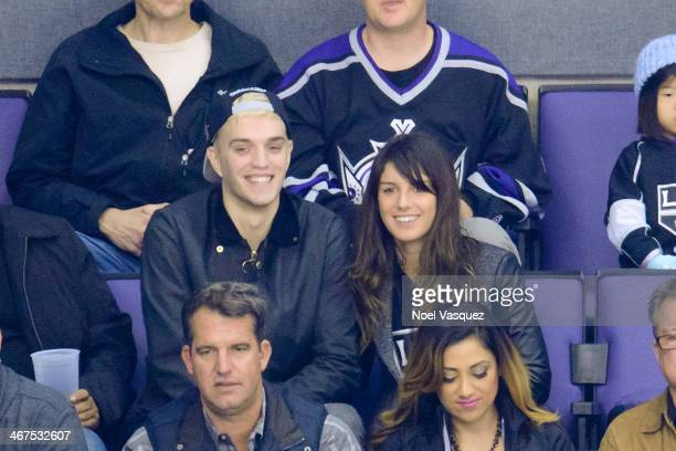 Shenae Grimes and Josh Beech attend a hockey game between the Columbus Blue Jackets and the Los Angeles Kings at Staples Center on February 6 2014 in...