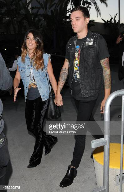 Shenae Grimes and Josh Beech seen at Staples Center on August 12 2014 in Los Angeles California