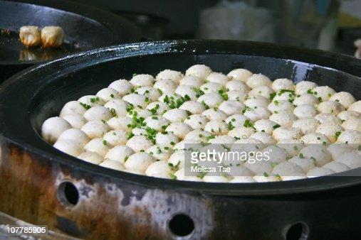 Shengjian mantou (buns) being pan-fried