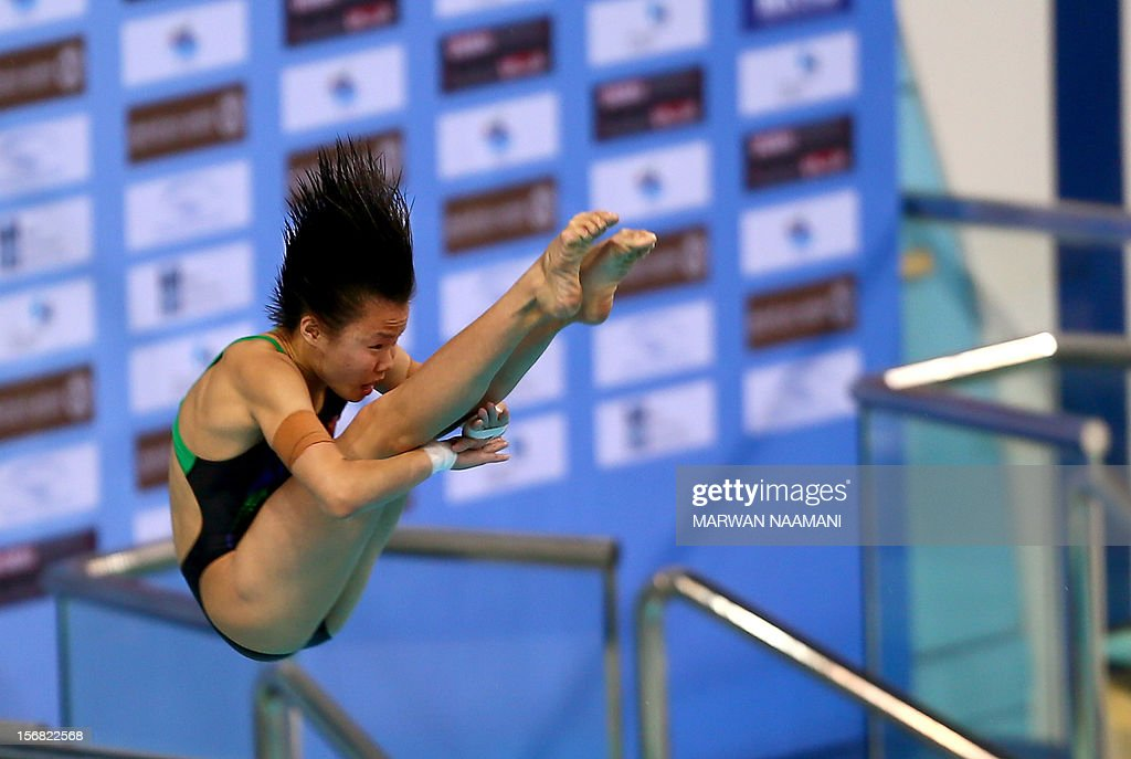 Shengping Wu of China performs in the women's 10m platform at the 9th Asian Swimming Championships in Dubai, on November 22, 2012. Shenping won the gold medal in the event.